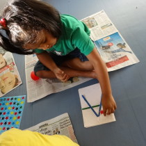 Participant busy with a craft activity - Toddler Art.