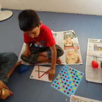 Participant busy with craft activity - Toddler Art.