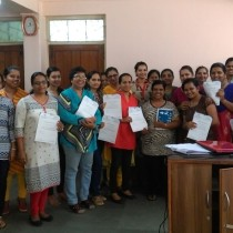 Participants of the teacher training at Little's with their certificates.